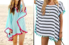 £10 instead of £39.99 (from Who Runs the World) for a pom pom fringe beach kaftan - choose aqua or stripe and save 75%