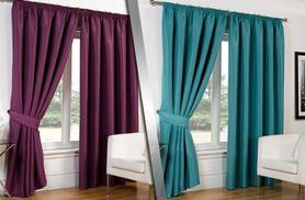 From £11.99 for a pair of faux silk blackout curtains in a choice of colours and sizes from Wowcher Direct - save up to 73%